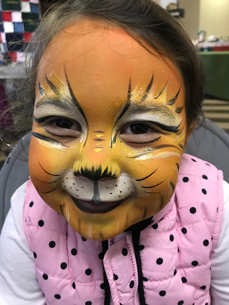 Girl painted as a Cat