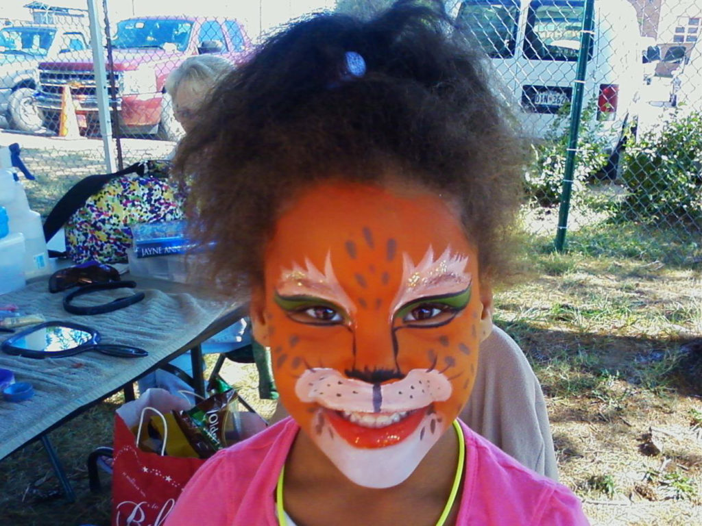 Girl with a tiger painted on her face