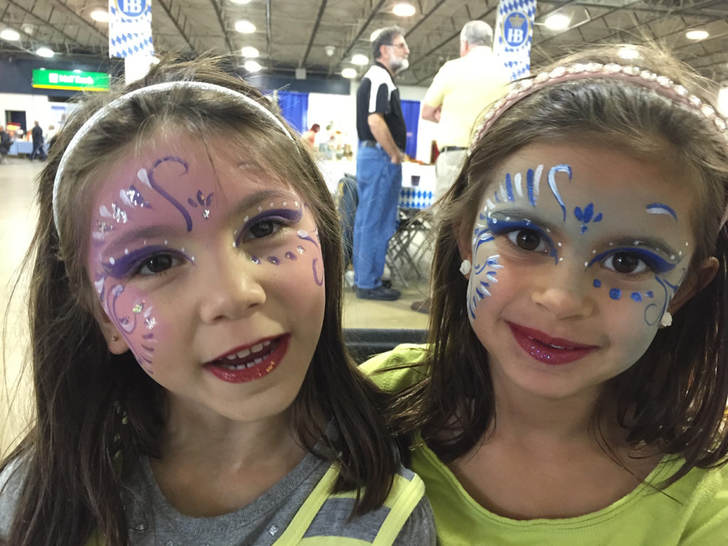 Sisters with their face painted as a princess