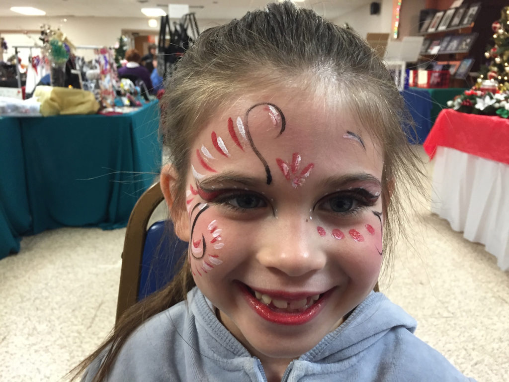 Girl with her face painted as a princess