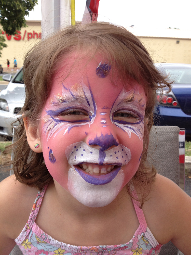 Girl with a cat painted on her face