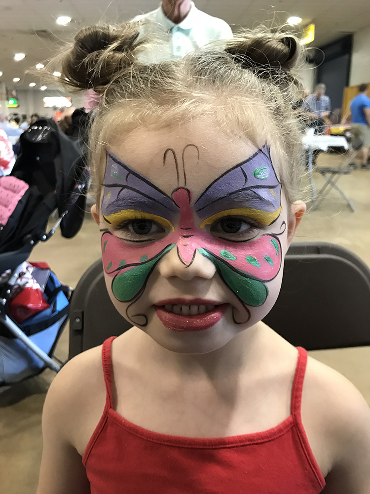 Girl with a butterfly painted on her face