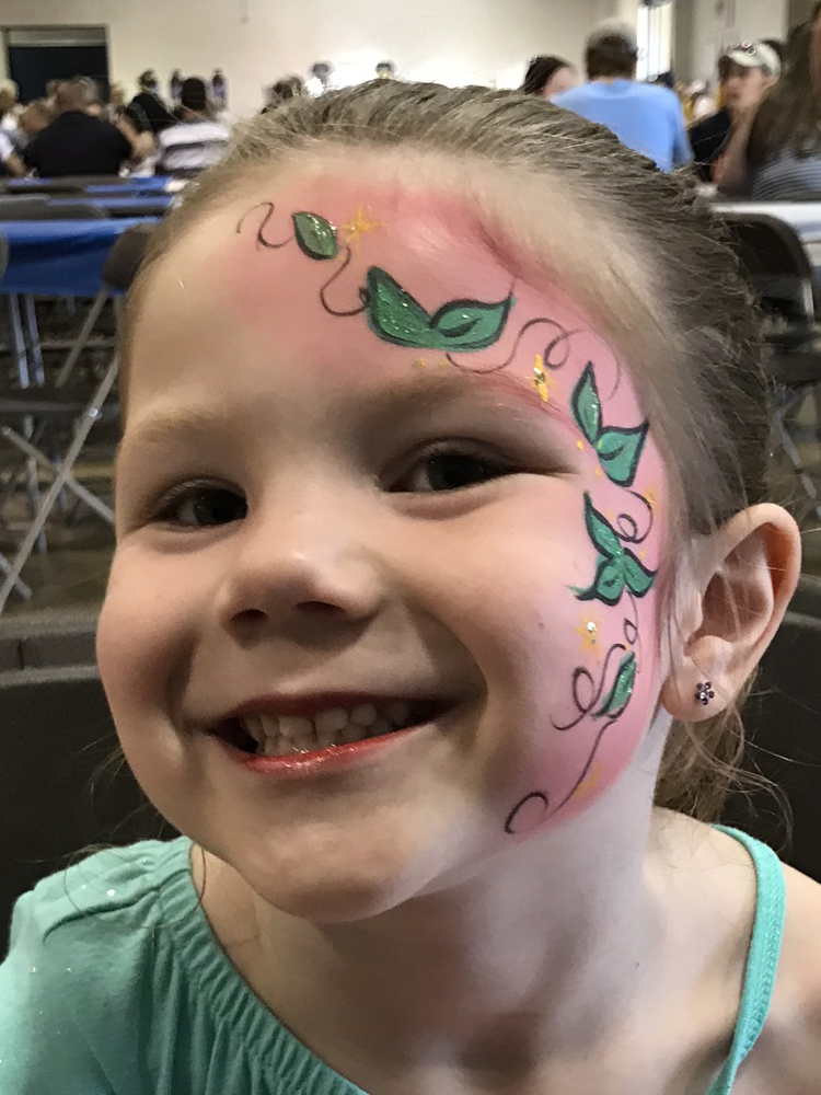 Girl with lilies painted on her face