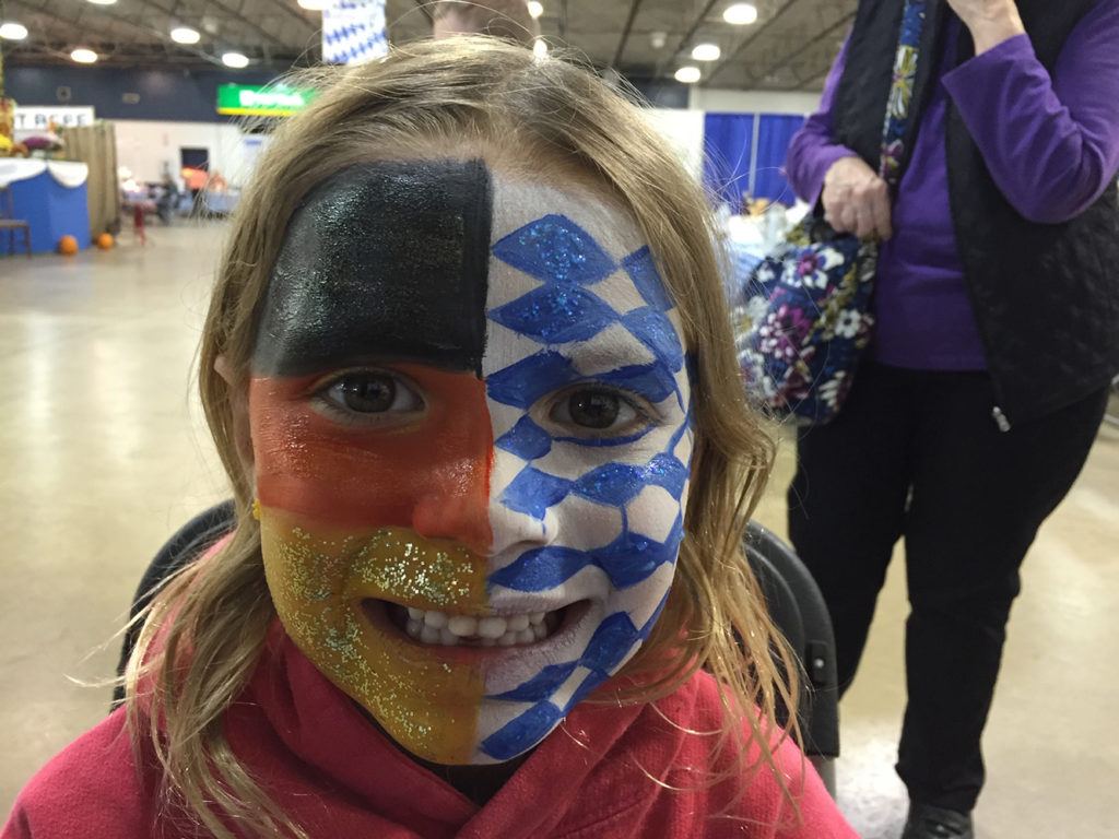 Girl with dual flags painted on her face