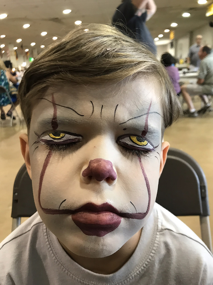 Boy painted as Pennywise the clown