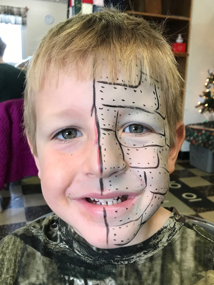 Boy painted as an android