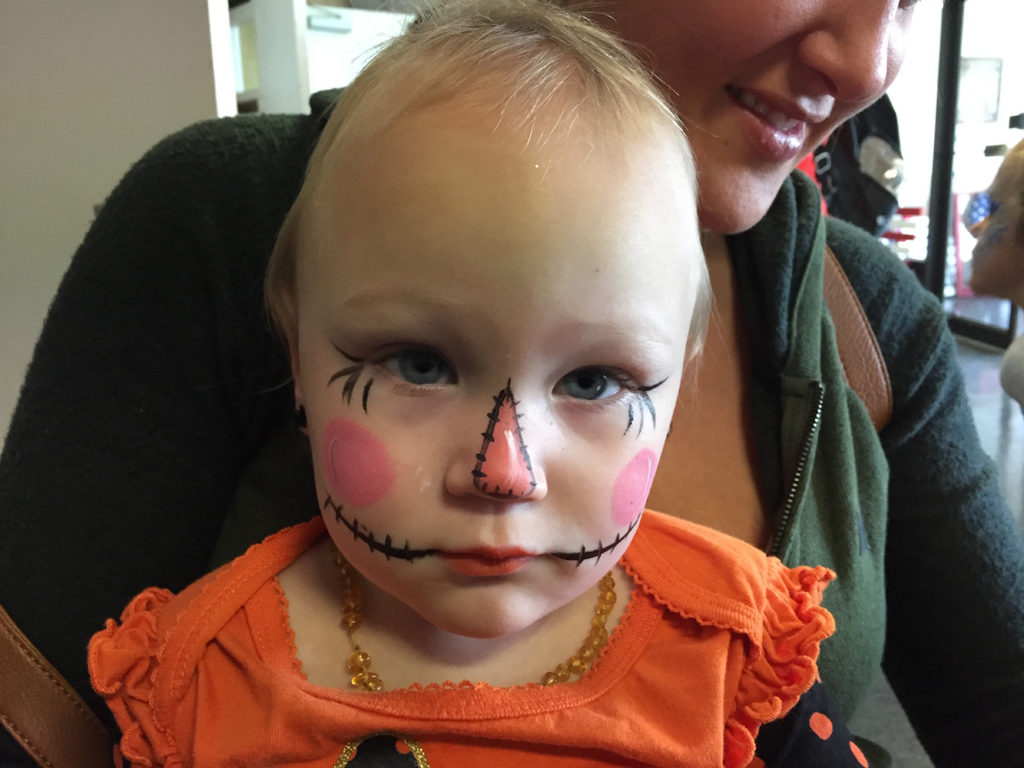 Baby painted as a pumpkin