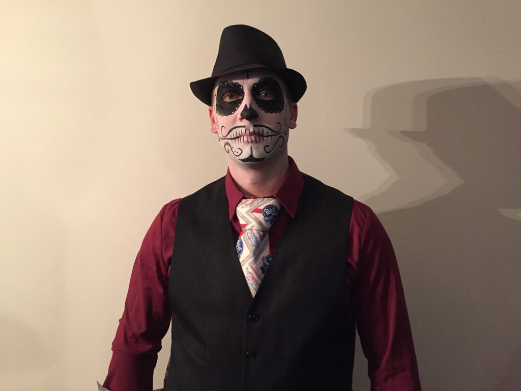 MAn dressed as a Day of the Dead character