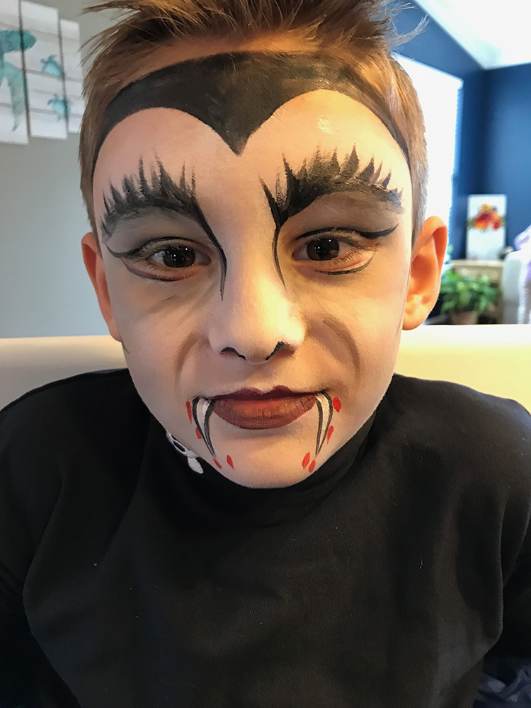 Boy painted as a Vampire