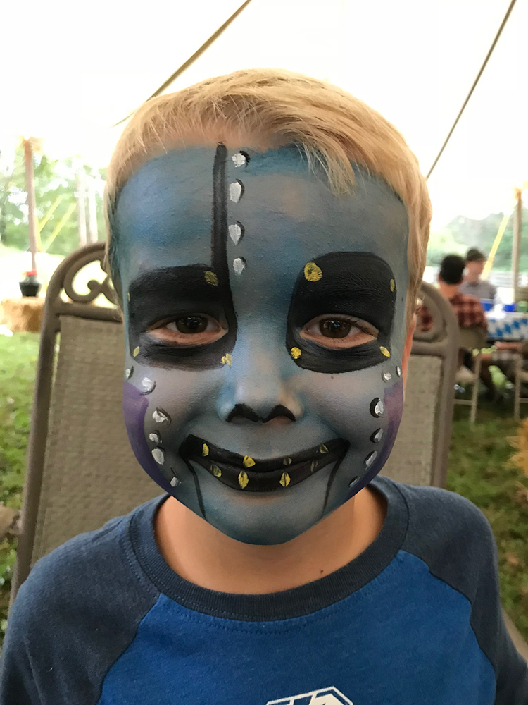 Boy painted as a Android