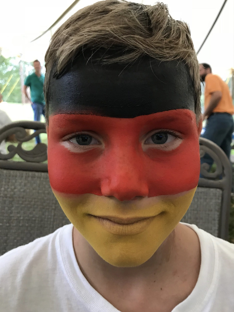 Boy with the German flag painted on his face
