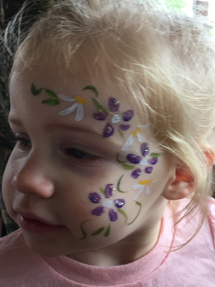 Girl with flowers painted on her face
