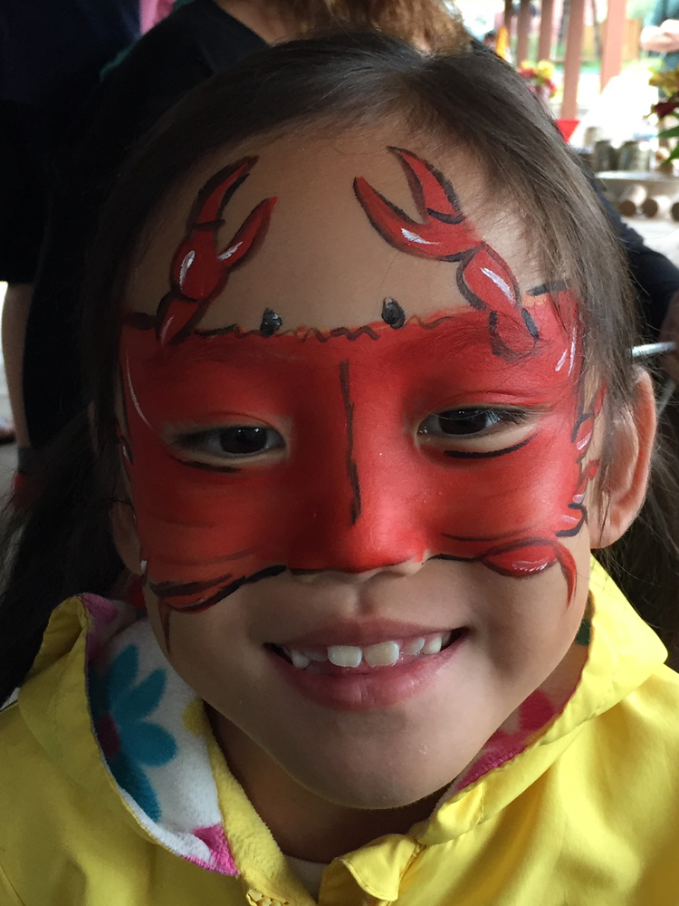 Girl with a crab painted on her face