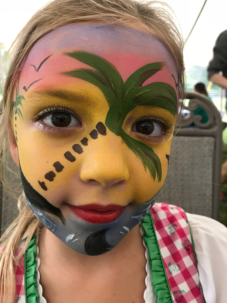 Girl with beach scene painted on her face