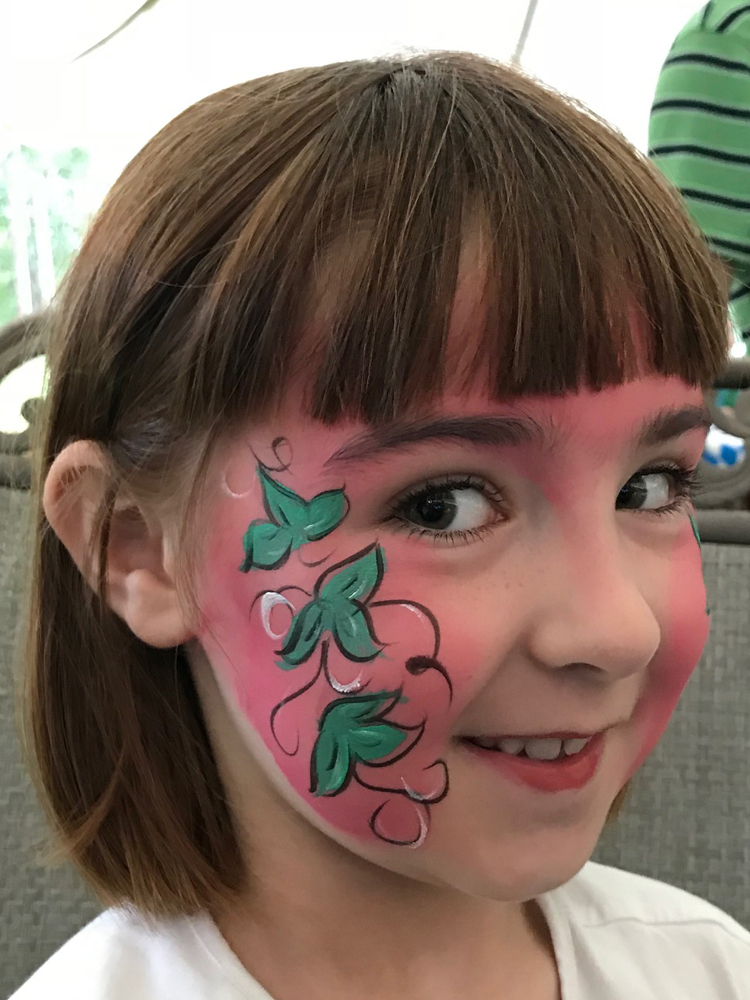 Girl with a flower painted on her face