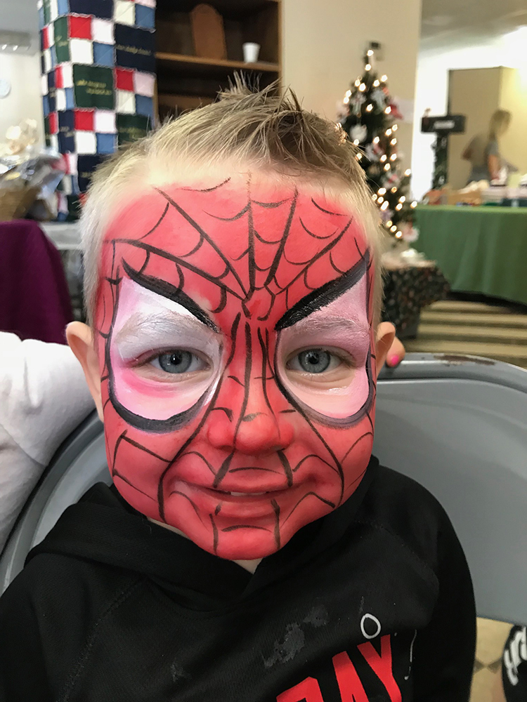Boy painted as Spiderman