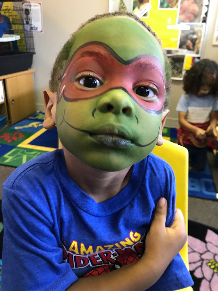 Boy painted as a Teenage Mutant Ninja Turtle
