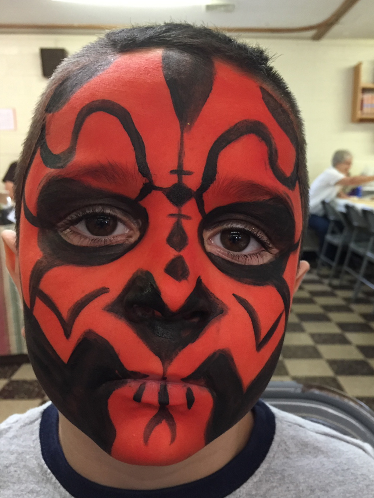 Boy painted as Darth Maul