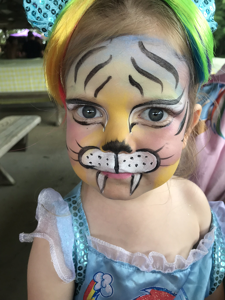 Girl painted as a tigers