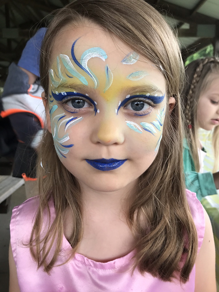 Girl with wavs painted on her face