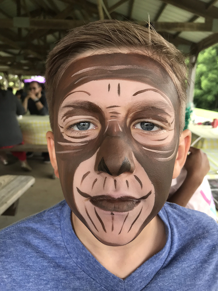 Boy painted as a monkey