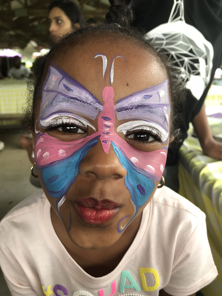 Girl painted with a butterfly on her face