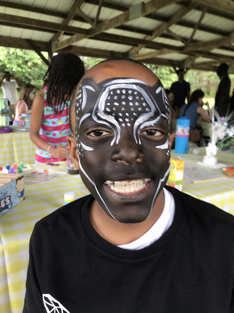 Boy painted as the Black Panther